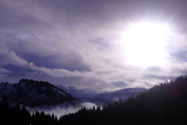 Sunset on a snowed valley
